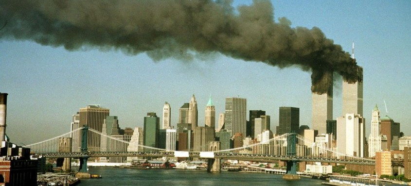 A September 11, 2001 file photo shows the towers of New York's World Trade Center pour smoke shortly after being struck by hijacked commercial aircraft. New York City plans to mark the third anniversary of the attacks on the trade center with an observance at the site on September 11 with parents and grandparents of victims reading their names. REUTERS/Brad Rickerby  JDP
